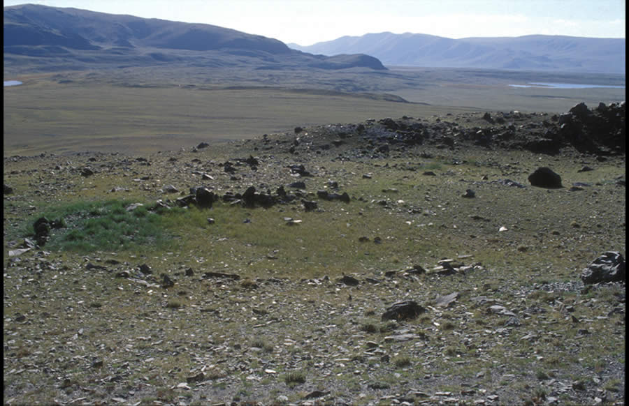 Two large circles within a ritual site. Date uncertain. Baga Oigor IV, Tsagaan Salaa/Baga Oigor complex. View to northeast.Large circles appear on terraces or ridges, alone or by twos. The function and age of large circles are uncertain.