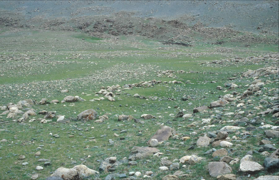 Three attached circles or semi-circles. Date uncertain. Left bank Khöltsöötiin Gol. View west.Semi-circles occur alone or by twos, but they are unusual with the Mongolian Altai. Their function and age are uncertain.