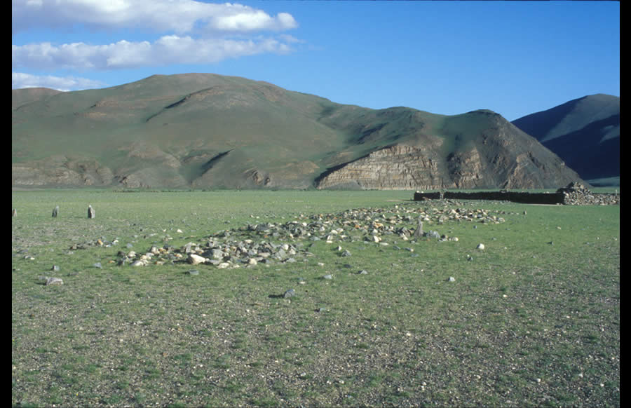 A sequence of burial mounds terminating at a modern Kazakh cemetery, left bank 	Sagsay Gol. Early Nomadic period, recent.