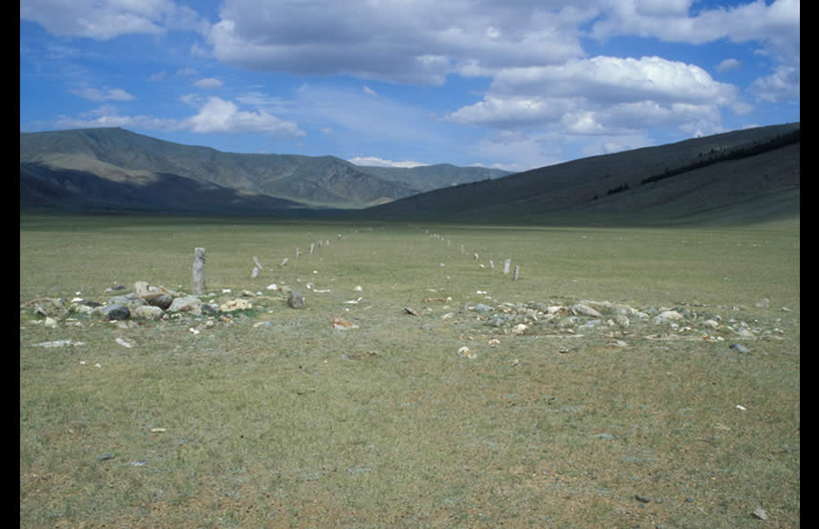 Two enclosures, one false image stone, and two lines of balbal extending approximately 300 m. Turkic period. Mogoityn Am, valley of Mogoityn Gol. View east.